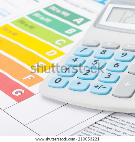 Energy efficiency chart with calculator - studio shot - stock photo