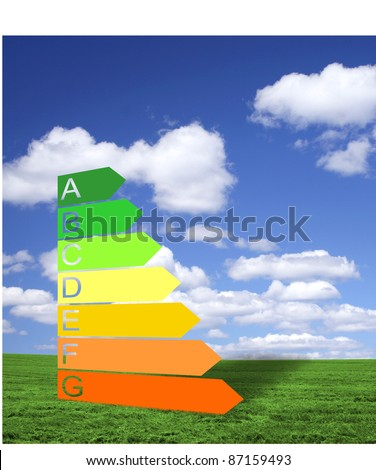 Energy efficiency classification on a green field - stock photo