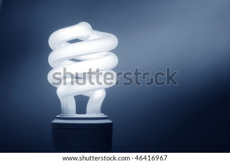 Energy efficient CFL compact fluorescent light bulb lamp - stock photo