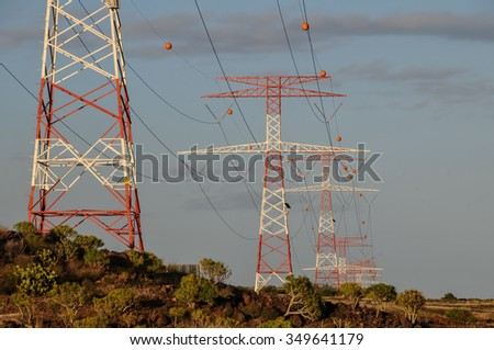 Energy Electricity Power Pylon on a Blue Sky