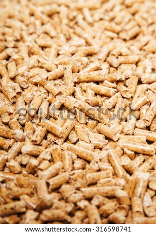 Energy. Pellets on the table - stock photo