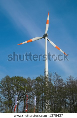 Energy-producing windmill waiting for the strong wind