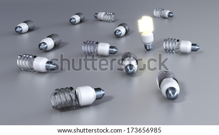 Energy save bulbs on grey background - stock photo