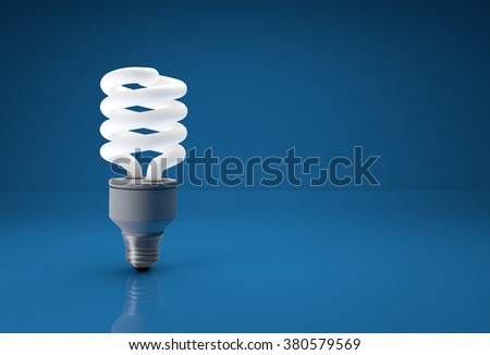 Energy saving bulb on blue background with place for copy text. - stock photo