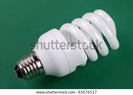 energy saving bulb on green background - stock photo