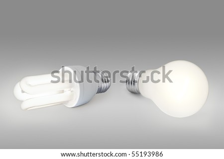 Energy saving concept: a low energy light bulb against a normal light bulb - stock photo