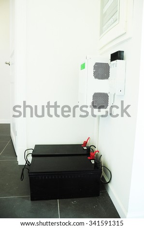 Energy Saving concept. Accumulating and consumption of of solar electric power. Solar panels, transformers and batteries. Home appliances. - stock photo