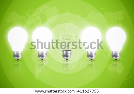 Energy saving concept with light bulb on the background color, Elements of this image furnished by NASA.