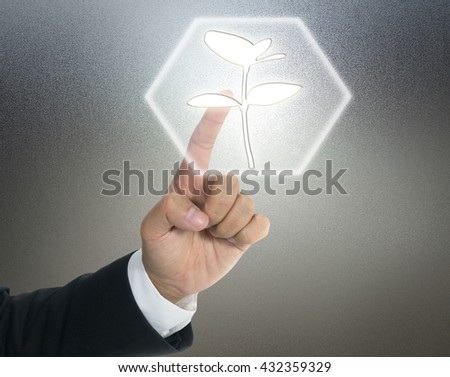 Energy saving concept with light young plant - stock photo