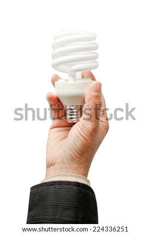 Energy saving fluorescent light bulb and hand - stock photo