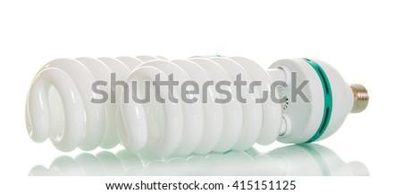 Energy saving fluorescent light bulb isolated on white background. - stock photo