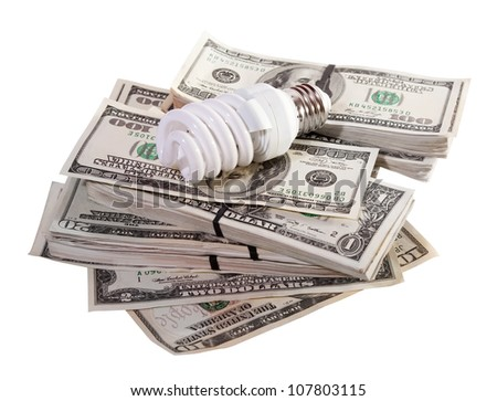 Energy saving fluorescent light bulb on dollars. Isolated on white background