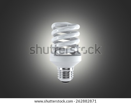 Energy saving fluorescent lightbulb on a dark bakground  - stock photo