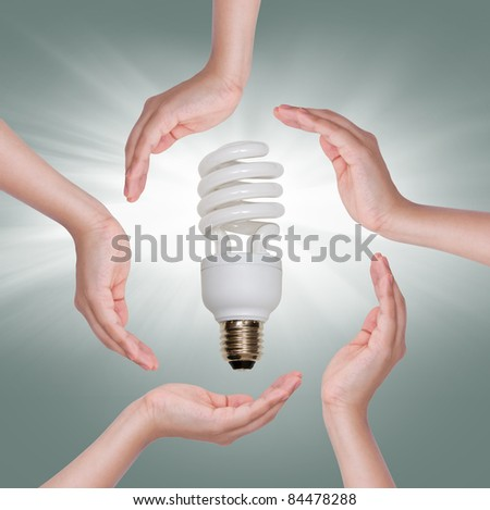 Energy saving fluorescent spiral light bulb in hand isolated on white background