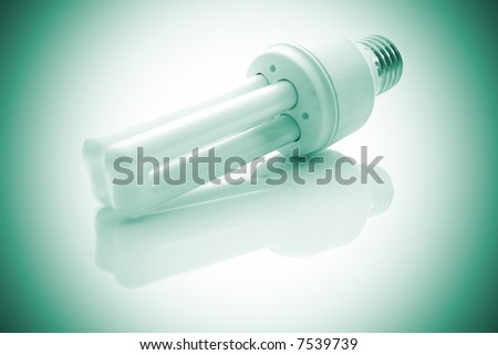 Energy saving lamp with green cross process look. Subtle reflection under It. - stock photo