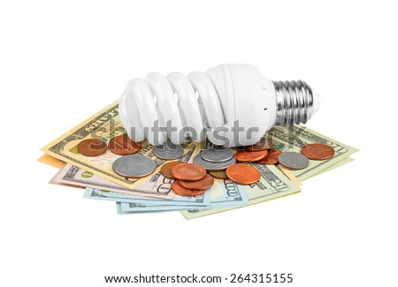 Energy saving light bulb and money on white