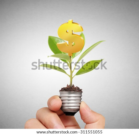 Energy saving light bulb, Creative light bulb idea in the hand - stock photo