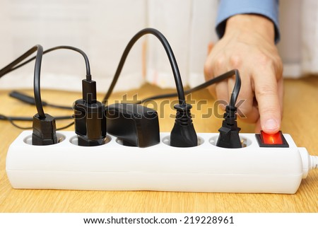 energy savings with turning off electrical appliances - stock photo