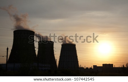 energy station with smoke at winter sunset