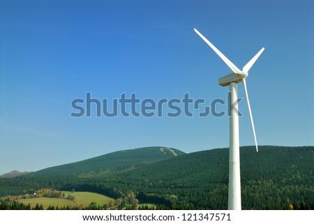 Energy wind turbine at mountain background - stock photo