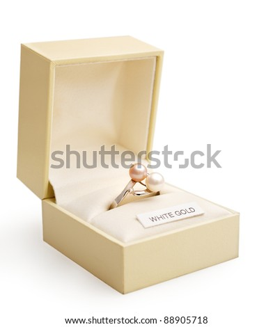 Engagement ring of white gold and pearls in an elegant jewlry box. - stock photo