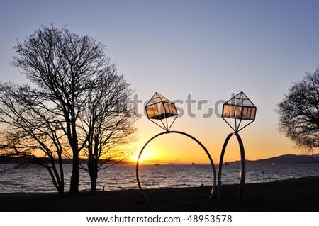 Engagement rings street lamps at English Bay - stock photo