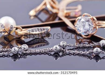 engagement silver ring with precious stones and fine silver chain - stock photo