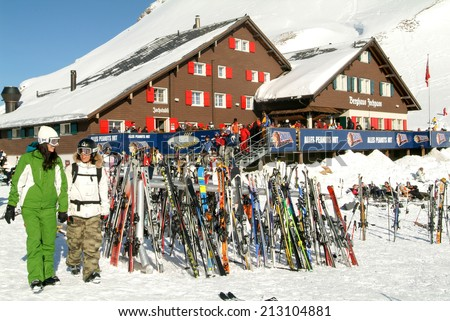 Engelberg, Switzerland - 11 March 2007: Skier in front of a restaurant on the ski slopes at Engelberg on the Swiss alps - stock photo