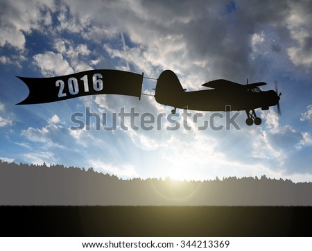 Engine airplane flying at sunset. Concept of New Year 2016 - stock photo