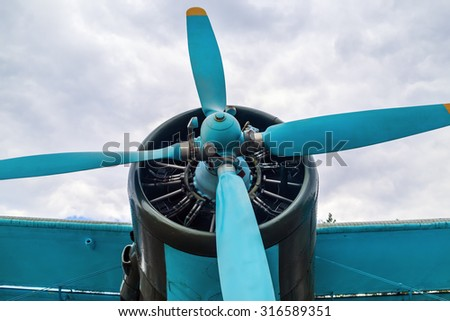 Engine and propeller of old vintage retro style airplane - stock photo