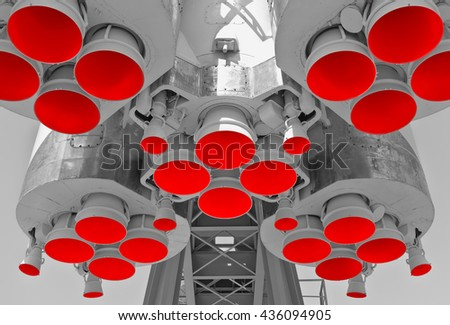 Engine and red nozzles of space rocket - stock photo