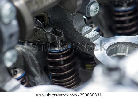 engine closeup parts, valves, bolts - stock photo