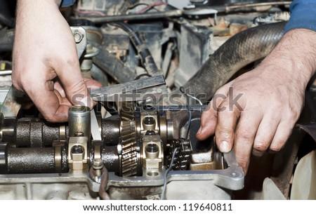 Engine repair close up. In hands tool. - stock photo