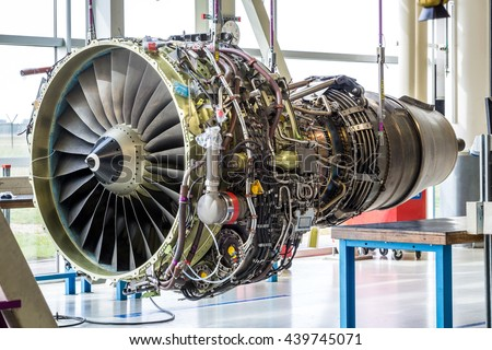 Engine's maintenance in huge industrial hall - stock photo