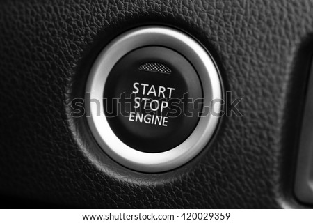 Engine start button in car - Black and White