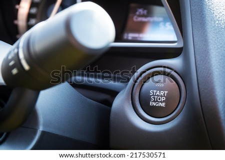 Engine start stop button in the car - stock photo