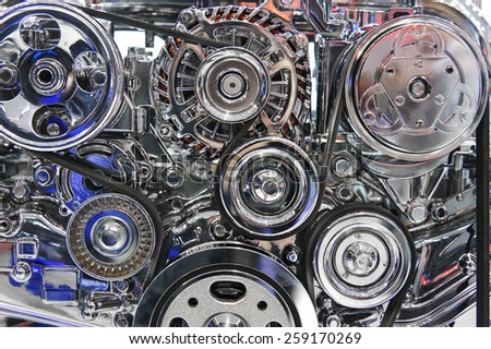 Engine with metal and chrome parts of the automobile motor - stock photo