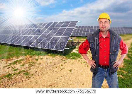 Engineer against solar panels. - stock photo