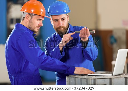 Engineer and foreman in factory. - stock photo