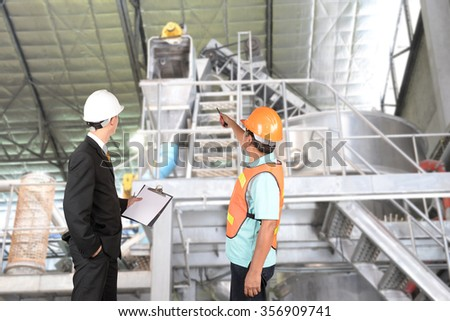 Engineer and supervisors are checking manufacturing.