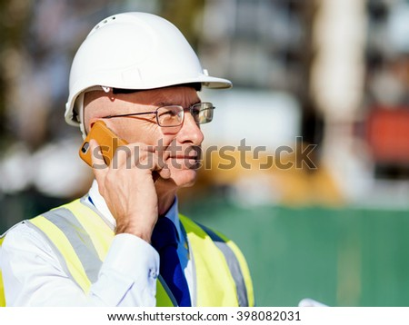 Engineer builder at construction site
