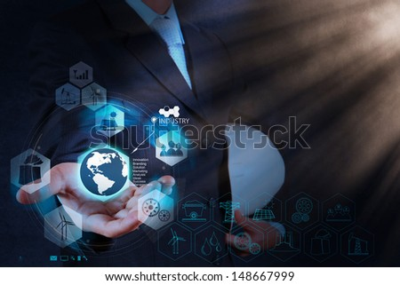 engineer businessman hand show world of industry as concept