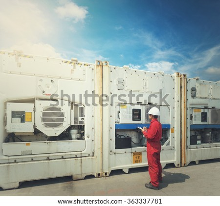 engineer checking temperature in front of Reefer Container box at  yard - stock photo
