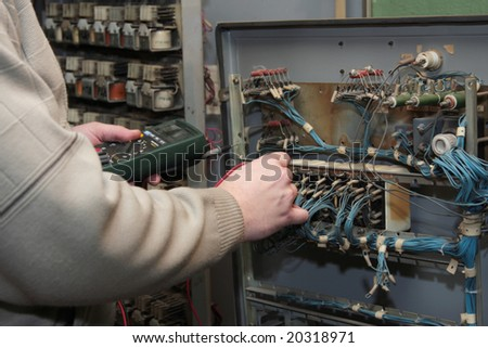 Engineer checks the electrical circuit - stock photo