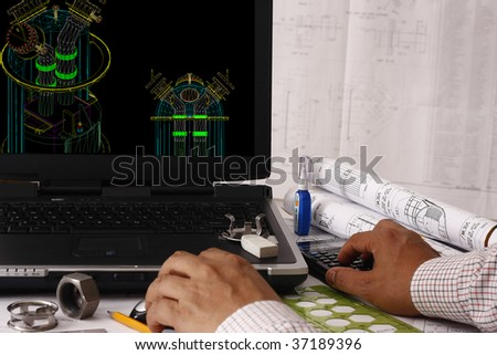 Engineer doing a model review in his 3D pressure vessel design - many uses in oil & gas industry. - stock photo