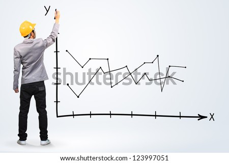 engineer drawing a graph - stock photo