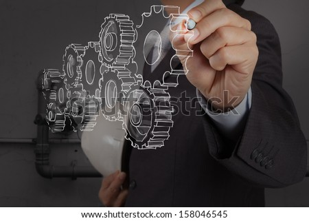 engineer drawing  gear with the piping of an industrial waste water cleaning facility as concept - stock photo