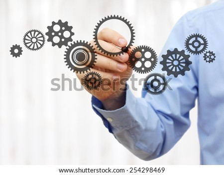engineer draws a chain sprockets. Technology and industry concept - stock photo