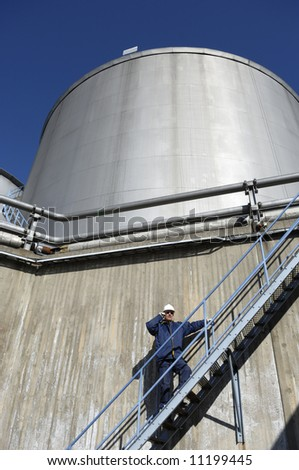 engineer, fuel-storage and oil tanks - stock photo