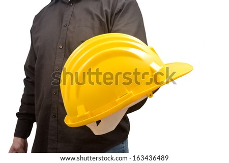 engineer giving a protective helmet with his hand. Concept of safety in the workplace